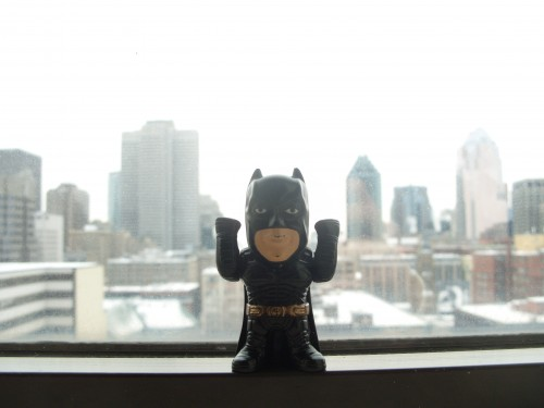 The Dark Knight over Daylit Montreal